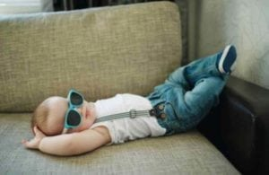 baby on couch with sunglasses