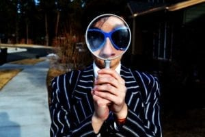 man in a suit with a magnifying glass